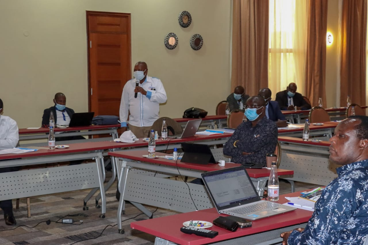 Isaac Gathirwa, KNQA Council member addressing the KNQA Council on the KNQF Act and KNQA Regulations during the induction workshop for the council