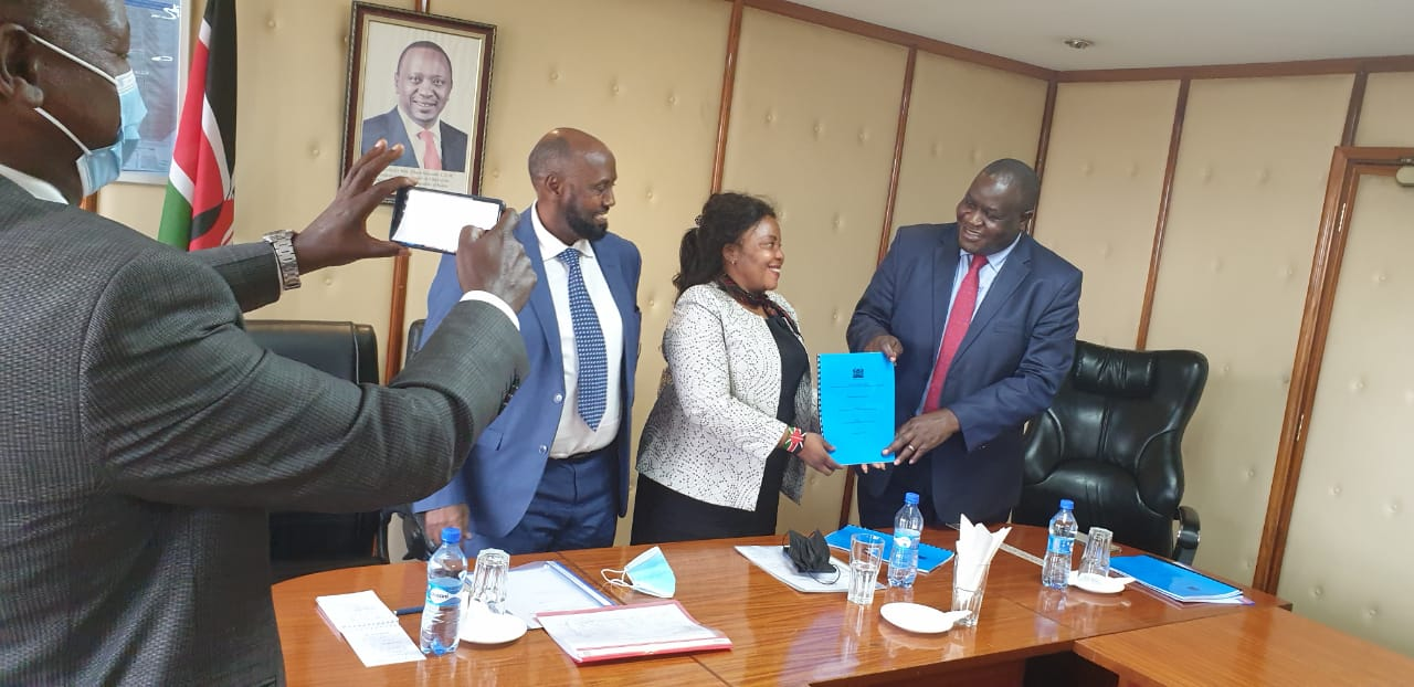 The outgoing PS VTT Dr. Julius Jwan hands over to the incoming PS Dr. Margaret Mwakima.