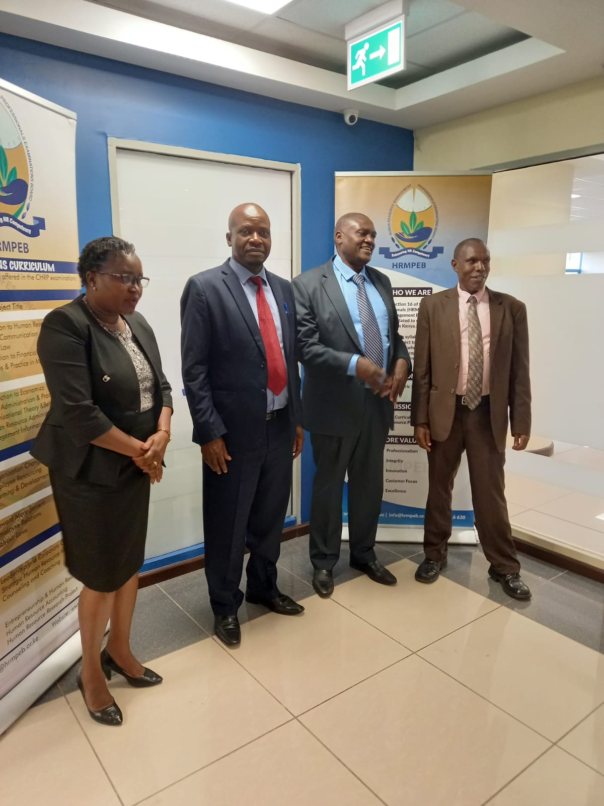 KNQA Director Technical Services S. Maindi(2nd L) & HOD Registration, Accreditation & Documentation J.Tegeret(R) with HRMPEB CEO Dr.Douglas Ogolla(2nd R) & Manager Examinations Jane Wanyoike(L) during the opening of a joined meeting on Accreditation of HRMPEB as a QAI and her qualifications